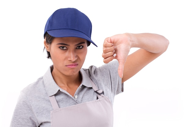 Unhappy female worker giving thumb down gesture