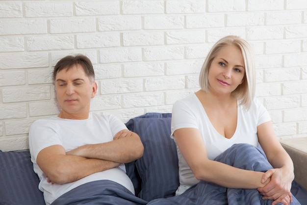 Unhappy middle aged couple has problems in relationships. conflict in family concept. tired from long relationship. difficulties in sex.