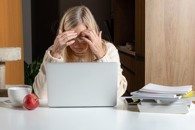 Unhappy upset  middle aged female confused depressed with financial problems or debt paying online