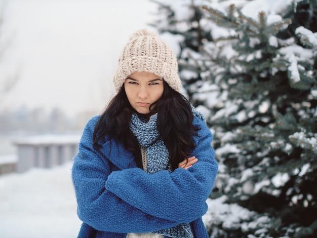 Unhappy winter woman outdoors
