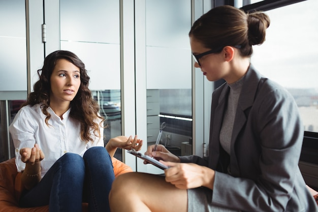 Unhappy woman consulting counselor