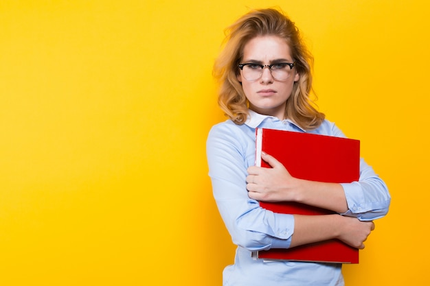 Unhappy woman with big folder