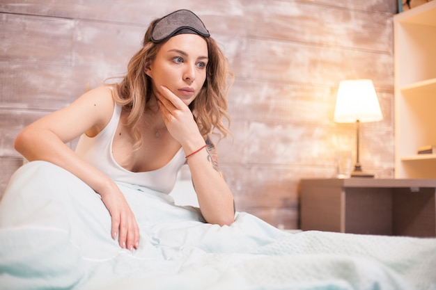 Unhappy young woman because she can't sleep. attractive woman with insomnia.