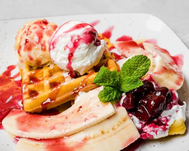 Unhealthy waffles with bananas close up