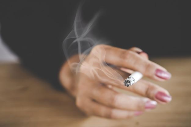 Unhealthy woman hand smoking cigarette