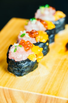 Uni sushi with otoro tuna and salmon egg on top