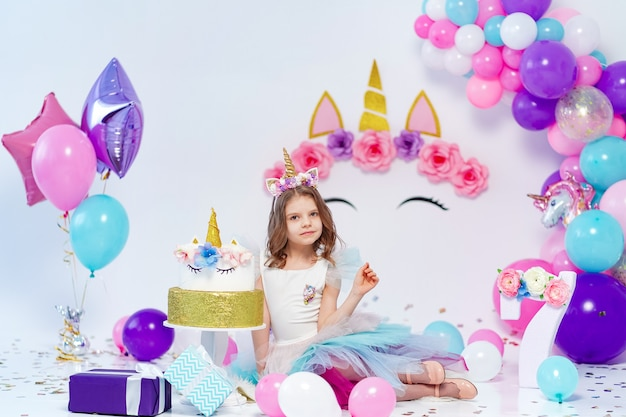 Unicorn girl holding gift box. idea for decorating unicorn style birthday party. unicorn decoration for festival party girl