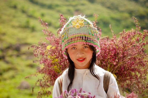 Unidentified ethnic minority kids with baskets of rapeseed flower in hagiang, vietnam. hagiang is a northernmost province in vietnam