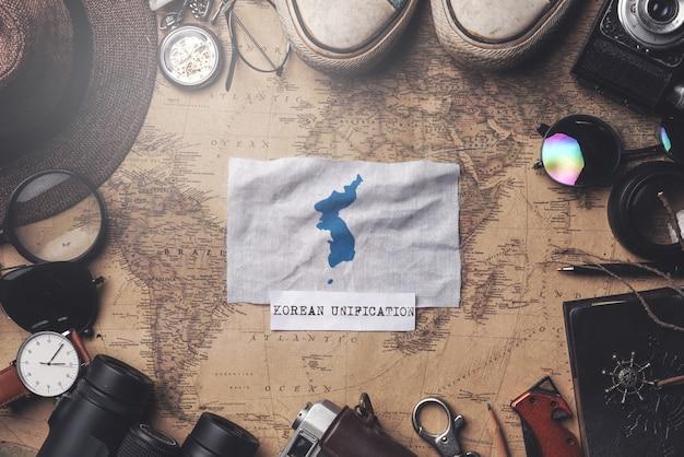 Unification flag of korea flag between traveler's accessories on old vintage map. overhead shot