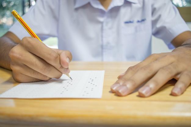 Uniform school asian students taking exams