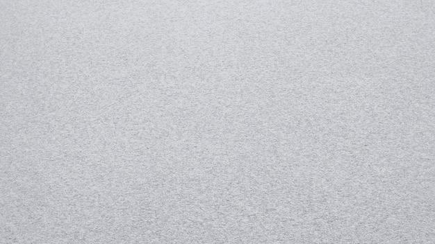 Равномерный снежный покров. текстура снега на ровном участке земли