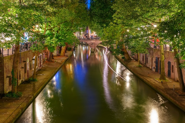 Unique embankments with two levels along the oudegracht at night utrecht netherlands