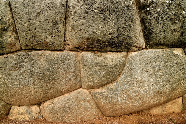 Unique inca stonework of sacsayhuaman citadel stone wall, unesco world heritage site in cusco, peru