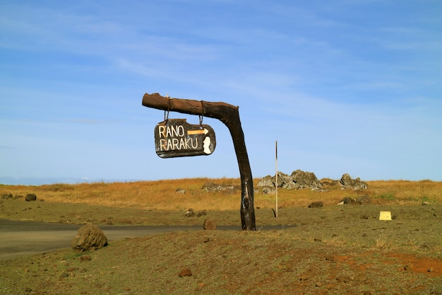 Unique roadside signpost for rano raraku volcano against blue sky, archaeological site on easter island, chile