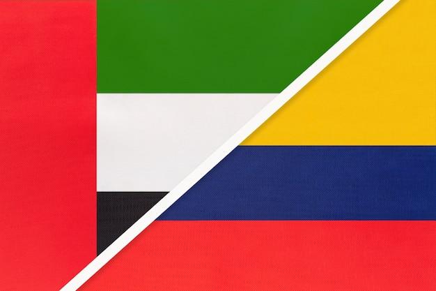 Объединенные арабские эмираты или оаэ и колумбия, символ двух национальных флагов из текстиля.