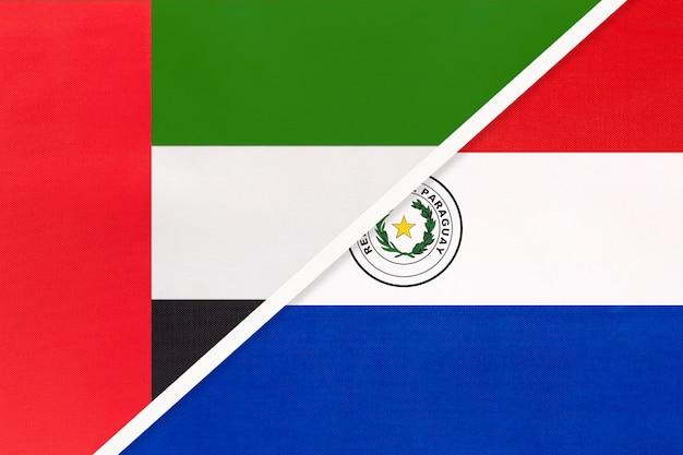 アラブ首長国連邦またはuaeとパラグアイ。テキスタイルの2つの国旗のシンボルです。