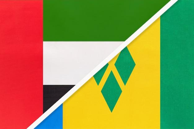 アラブ首長国連邦またはuaeとセントビンセントおよびグレナディーン諸島、テキスタイルの国旗のシンボル。