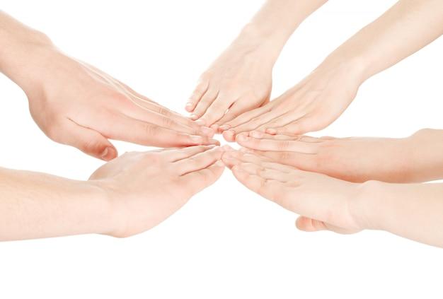 Соединенные руки на белом изолированные