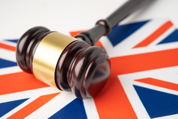 United of kingdom flag country with gavel for judge lawyer. law and justice court concept.