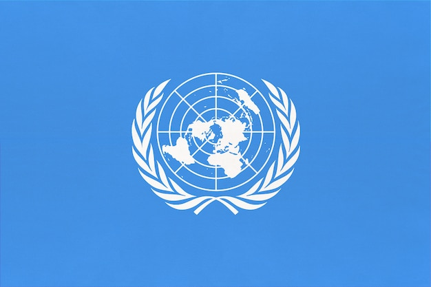 United nations un official flag. sign of the international community of world.