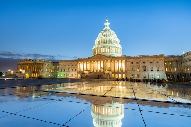 The united states capitol building at night in washington dc, united states of america