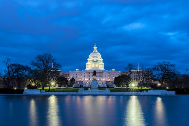 The united states capitol with reflection at night, washington dc, usa