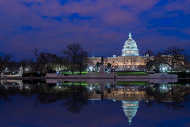 The united states capitol with reflection at night, washington dc, usa