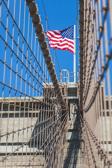 United states flag at top of brooklyn bridge