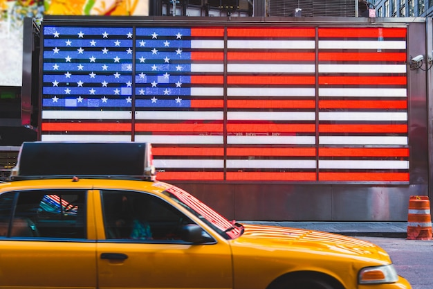 United states flag and yellow cabs