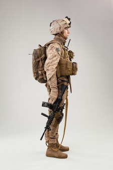 United states marine corps special operations command  raider with weapon. studio shot