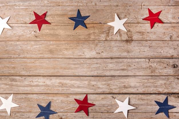Звезды соединенных штатов на деревянных фоне
