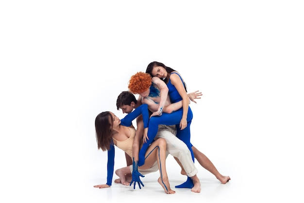 Unity. group of modern dancers, art contemp dance, blue and white combination of emotions. flexibility and grace in motion and action on white studio background. fashion and beauty, artwork concept.