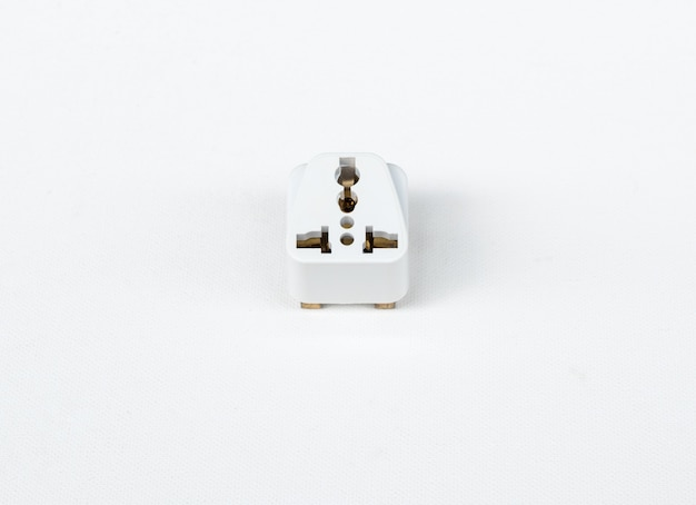 Universal adapter plug on the white canvas.