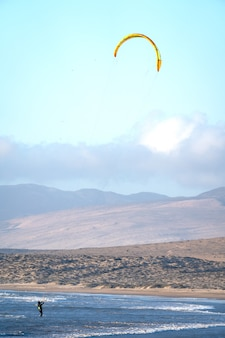 Unknown person doing kitesurfing in atacama chile