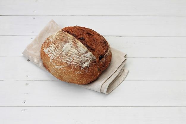 Unleavened healthy organic rye wheat homemade bread on white wooden.
