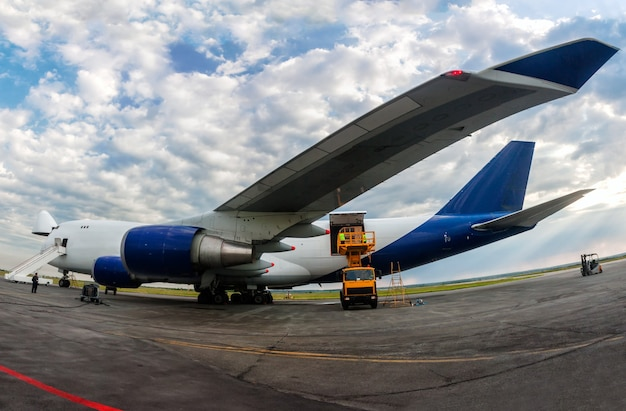 Unloading wide body cargo airplane