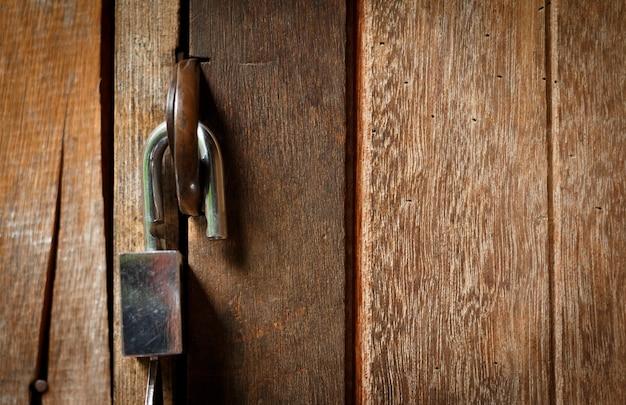 Unlock key on wooden door.open lock concept.