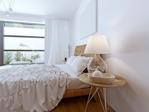 Unmade bed in bright contemporary room