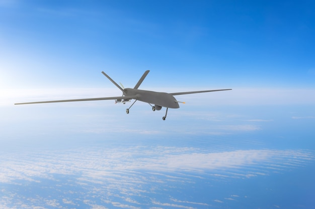 Unmanned military drone on patrol air at high altitude.