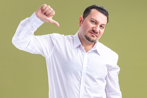Unpleased adult slavic businessman thumbing down