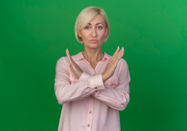 Unpleased young blonde woman doing no gesture at front