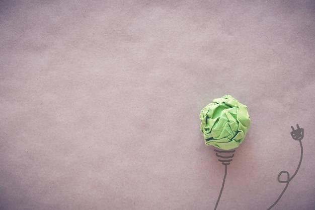 Unplugged green paper light bulb, eco energy saving concept