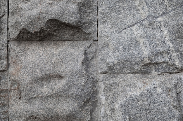 Unpolished grey stone wall,  with grunge texture