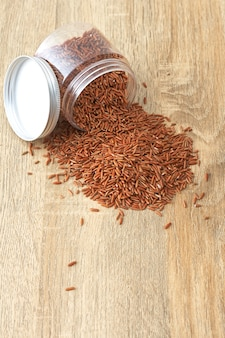 Unpolished red rice on white background. product of asia.