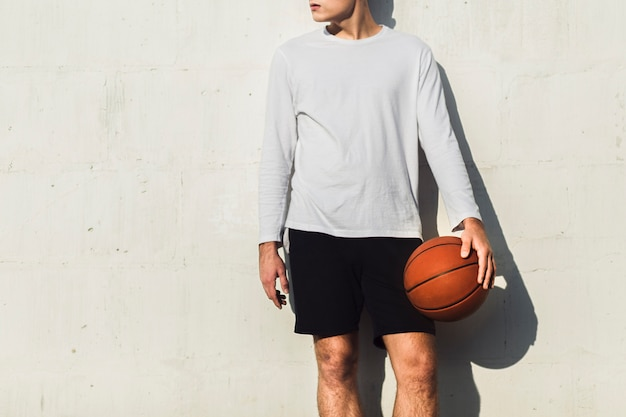 Unrecognisable basketball player looking away