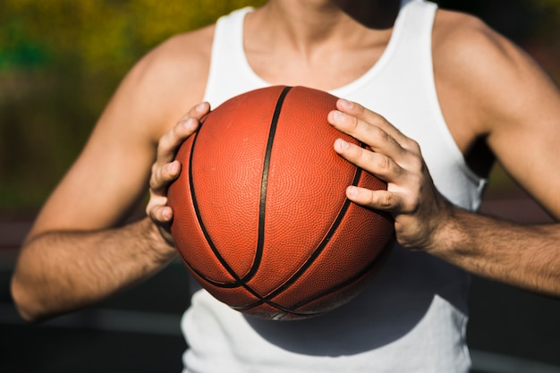 Unrecognisable player holding basketball