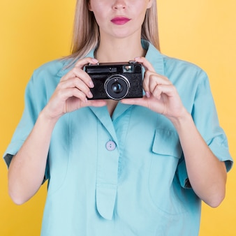 Unrecognisable woman holding camera