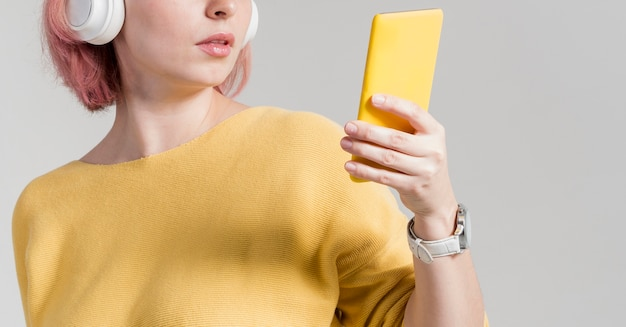 Unrecognisable woman looking at phone