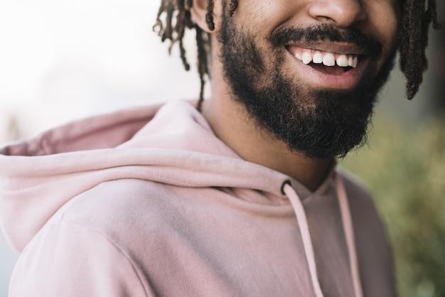 Unrecognizable afroamerican man smiling