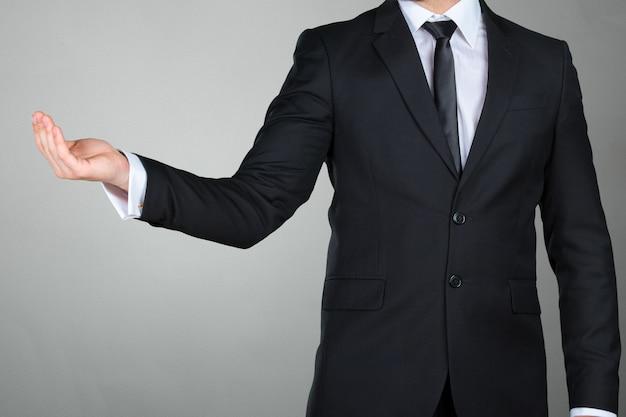 Unrecognizable businessman presenting copy space